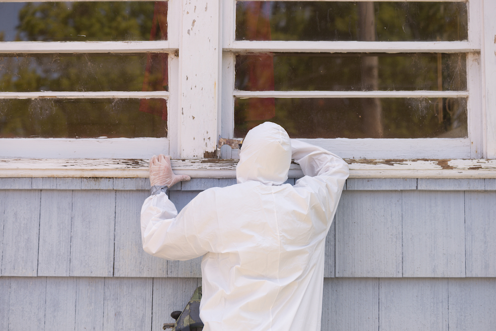 worker removing lead paint