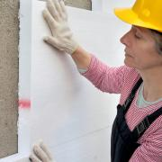 Woman insulating building